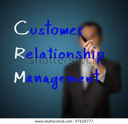businessman writing customer relationship management ( crm ) concept - stock photo