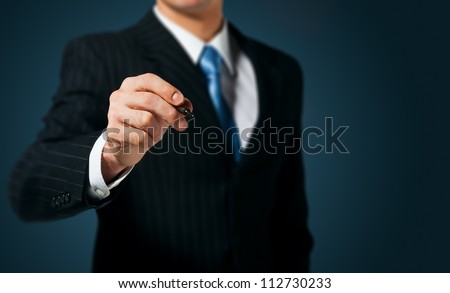 Businessman writing, drawing on the screen - stock photo