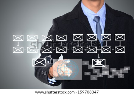 businessman writing e-mail schema on whiteboard - stock photo