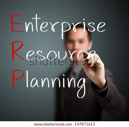 businessman writing enterprise resource planning (ERP) concept - stock photo