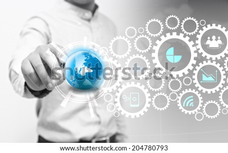 Businessman writing gears and business icons. - stock photo