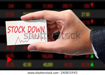 businessman writing graph of stock down. - stock photo