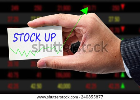 businessman writing graph of stock up. - stock photo
