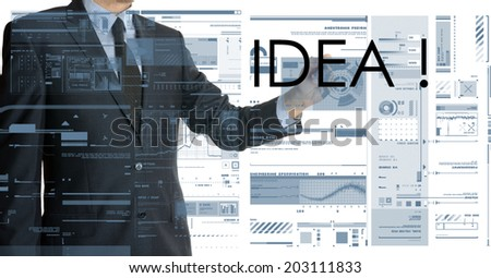 businessman writing idea and drawing graphs and diagrams - stock photo