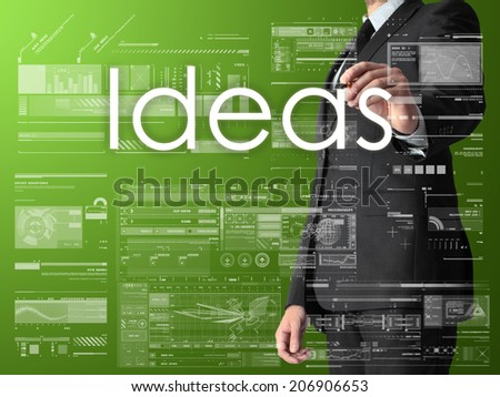 businessman writing ideas and drawing graphs and diagrams on green background - stock photo