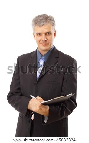 Businessman writing isolated over white background - stock photo
