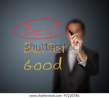 businessman writing mark on best choice - stock photo