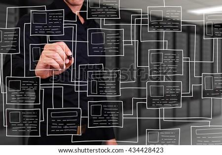 businessman writing mathematical formula - stock photo