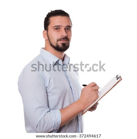 Businessman Writing on a Clipboard, Isolated. Young Man  with Hair Bun. Stock image - stock photo
