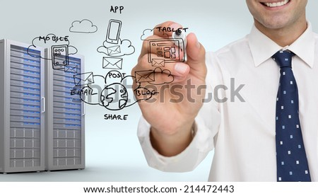 Businessman writing on camera with a black marker pen against digitally generated server tower - stock photo