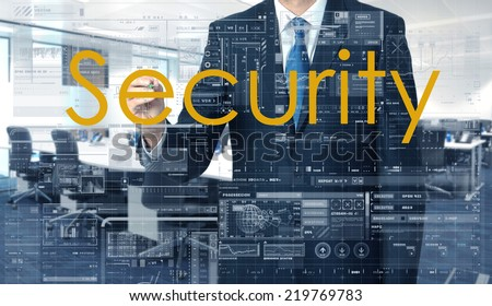 businessman writing on transparent board Security with office in background - stock photo
