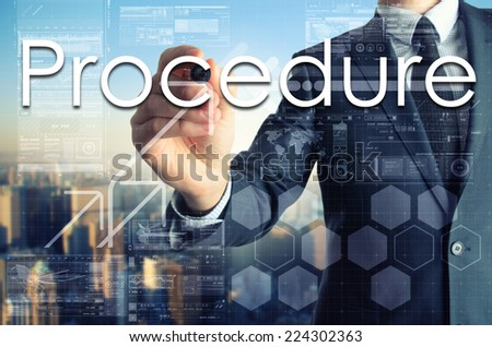 businessman writing  on transparent board with city in background  - stock photo