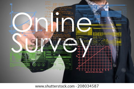businessman writing online survey and drawing graphs and diagrams  - stock photo