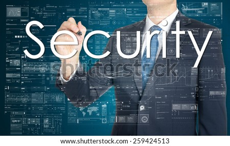 businessman writing Security and drawing some sketches  - stock photo