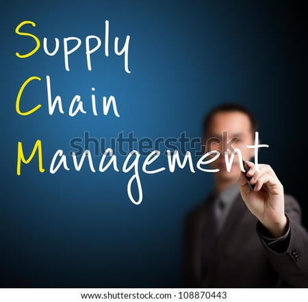 businessman writing supply chain management ( SCM) concept on whiteboard - stock photo