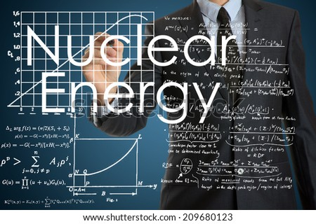 businessman writing technological terminology on virtual screen with modern business or technology background - Nuclear Energy - stock photo