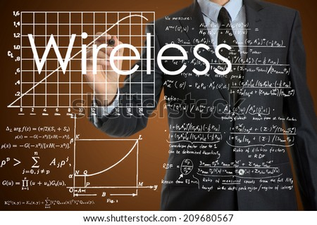 businessman writing technological terminology on virtual screen with modern business or technology background - Wireless - stock photo