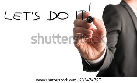 Businessman writing the message Let's do it with a black marker pen on a virtual screen or computer interface over white with copyspace in a conceptual image. - stock photo
