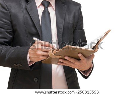 Businessman writing the note book on white background - stock photo