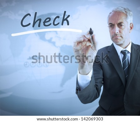 Businessman writing the word check with a marker - stock photo