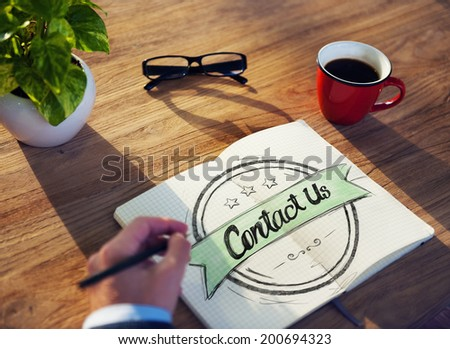 """Businessman Writing the Words """"Contact Us"""" - stock photo"""