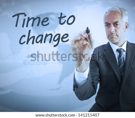 Businessman writing time to change with a marker - stock photo