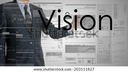 businessman writing vision and drawing graphs and diagrams - stock photo