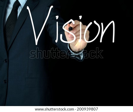 businessman writing  vision on black background - stock photo