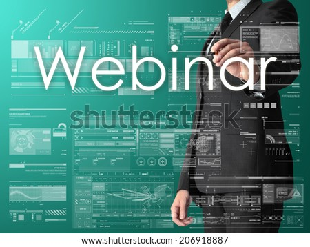 businessman writing Webinar and drawing some sketches  - stock photo