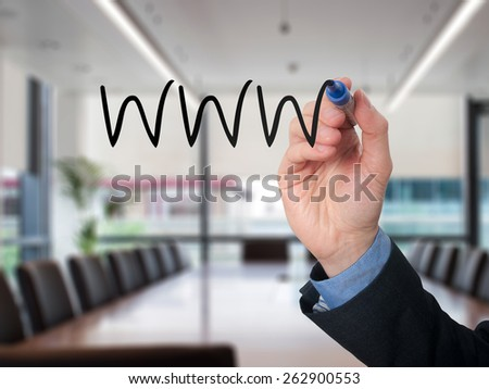 Businessman writing WWW on virtual screen with black marker. Isolated on office background.  - stock photo