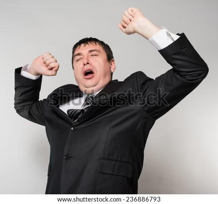 Businessman yawning over white background - stock photo