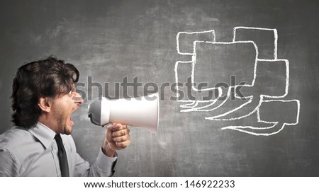 businessman yelling through a megaphone - stock photo