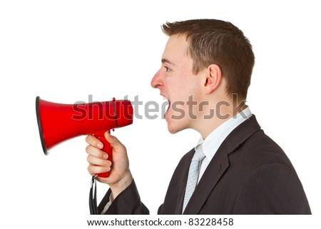Businessman yelling through a megaphone isolated on white background - stock photo