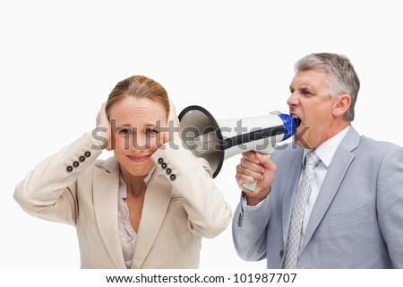 Businessman yelling with a megaphone after his colleague against white background - stock photo