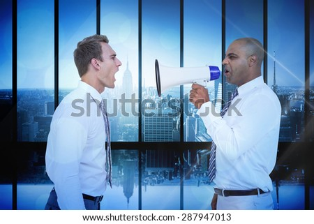 Businessman yelling with a megaphone at his colleague against room with large window looking on city - stock photo