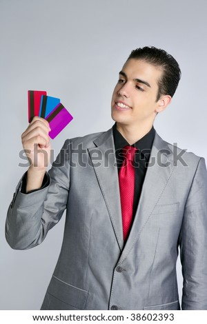 Businessman young with three credit cards in his hand - stock photo
