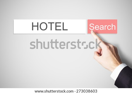 businessmans finger pressing red search button hotel webbrowser - stock photo
