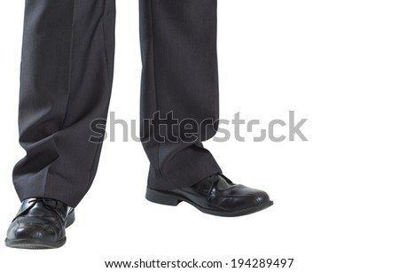 Businessmans legs and dress shoes on white background - stock photo