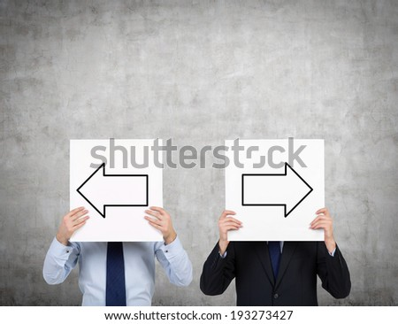 Businessmen and arrows 'left or right'  - stock photo