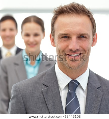 Businessmen and businessman posing together in a row in the office - stock photo