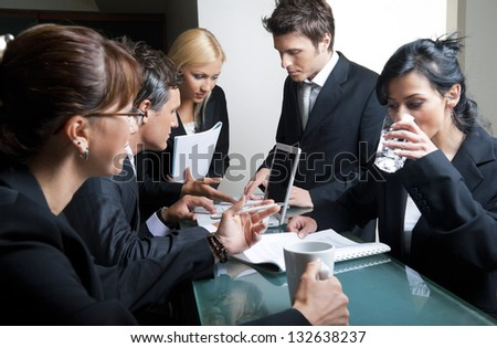 Businessmen and businesswomen having a meeting. - stock photo