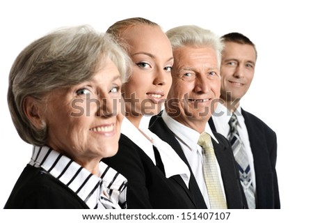 Businessmen and businesswomen looking at camera - stock photo