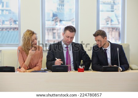 Businessmen and woman hold a meeting in the conference room - stock photo