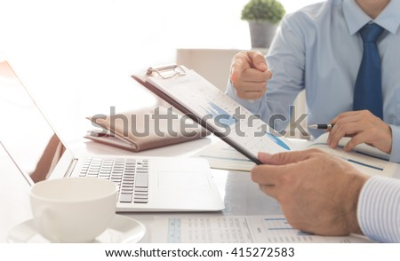 Businessmen are analyzing market data to clients or partners have been informed. Business Analysis Concept. - stock photo