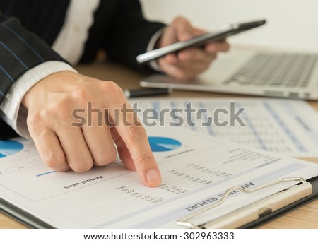 Businessmen are analyzing the data from the report. working concept. - stock photo