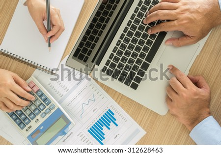 Businessmen are analyzing the data to business planning. top view. accounts concept. - stock photo
