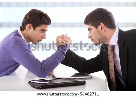 businessmen arm-wrestling. - stock photo