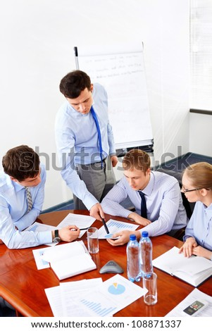 Businessmen at the office - stock photo
