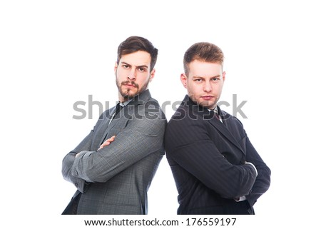 businessmen back to back beeing very serious on white background - stock photo