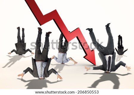 Businessmen burying their heads against red arrow pointing down - stock photo